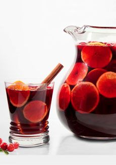 Winter sangria with cinnamon and clementines. http://blog.thenibble.com/2012/01/06/recipe-winter-sangria/  mmmmmmmmmmmm