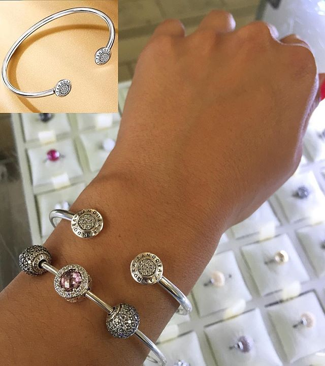 NEW ARRIVAL We fell in love with the new Signature Open Bangle, now available in all sizes at Miami International Mall! Plus, you have just a few hours to take advantage of our ESSENCE Collection offer - get an ESSENCE bangle bracelet and select charm for $75. Visit us now! #PANDORAMiaIntl