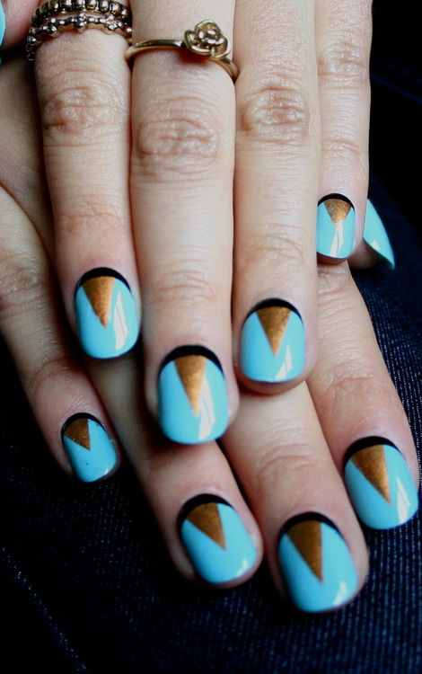 gold + blue nails.