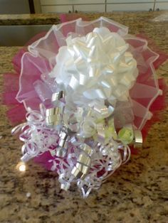 How to make a rehearsal dinner bouquet out of the bridall shower ribbions/bows.