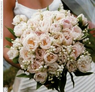 Bride's Bouquet Comprised Of: Pink Double Tulips, White Lily Of The Valley + Green Foliage