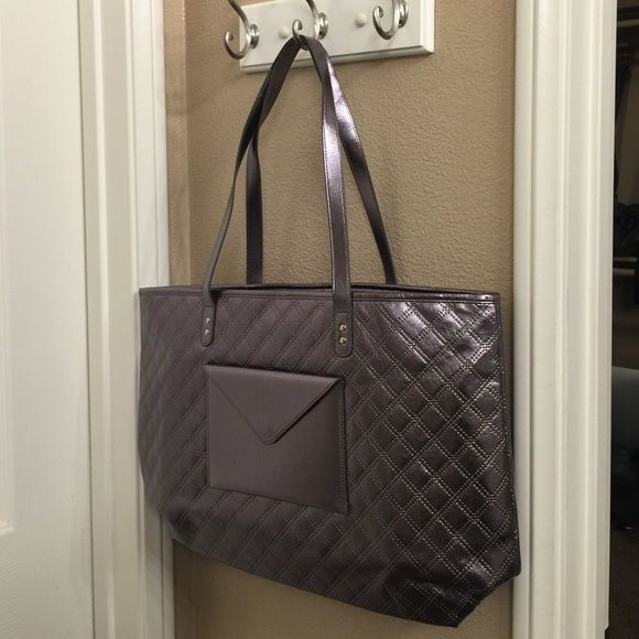 Metallic Bag NWT. Cute metallic bag with envelope style pocket. Large size. Silver with pink tint... Bath & Body Works Bags Shoulder Bags