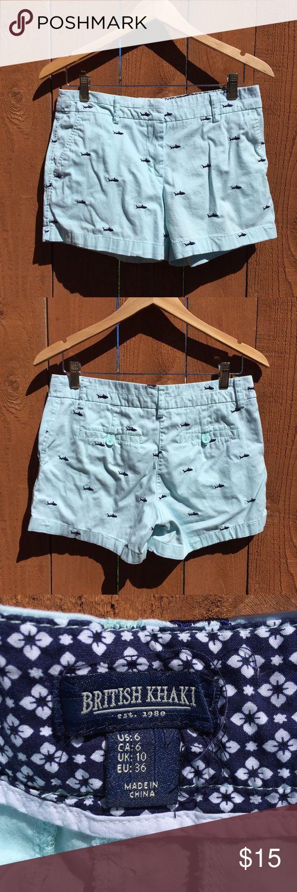 British Khaki shark print shorts blue 6 Gently used. Approximate flat measurements: waist 15in, length 12in, inseam 3.5in, front rise 9in. British Khaki Shorts