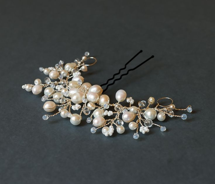 Handmade bridal headpiece with white freshwater pearls via Artual jewelry. Click on the image to see more!