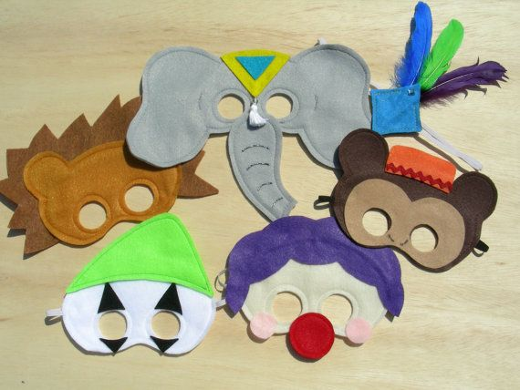 cute circus mask set would be fun for a photo booth. mahalo on etsy
