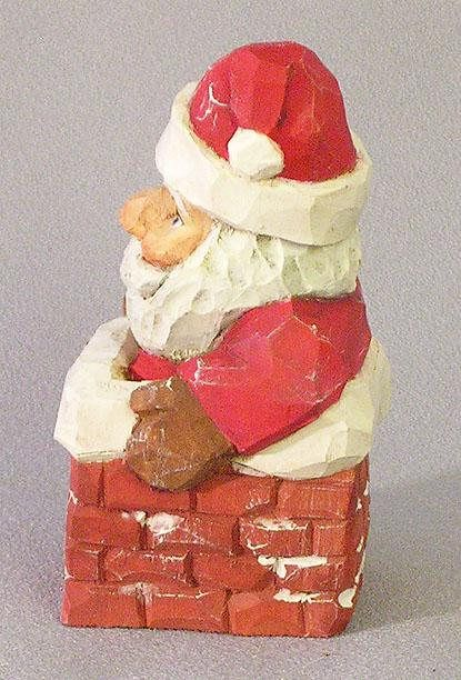 Santa woodcarving - Santa in chimney waiting to slide down to deliver gifts for Christmas, SA153 4 X 2 X 2 Hand-crafted wood carving. This folk-art wood art will brighten any holiday decor or would be an excellent addition to a Santa collection. Many people report they display their