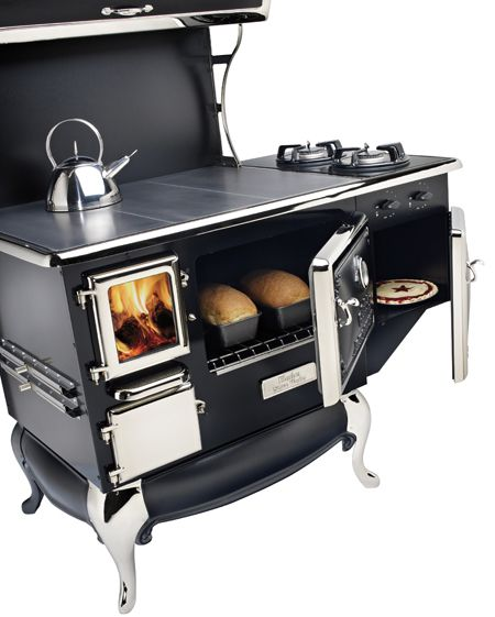 Best of both worlds! Wood oven with cooktop ( you can view the fire) and optional gas side burner and small oven.