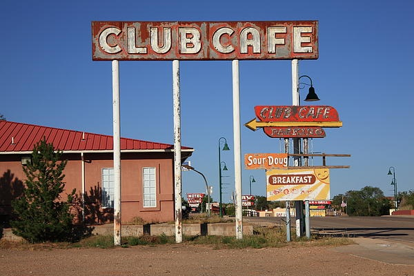 "Route 66 - Santa Rosa, New Mexico. Opened in 1935, the Club Cafe was a successful restaurant on the old road, in its day. It was closed in 1991, victim of the interstate that diverted traffic around Santa Rosa. All that remains now are some fading signs and a boarded up building. ""The Fine Art Photography of Frank Romeo."""