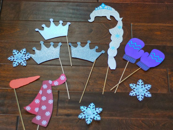 For the photo props....I used some winter themed printables from here.  Snowflake ornaments from Oriental Trading, and then just found a crown template and traced and cut out of glittered card stock.  We attached everything to wooden skewers.  For the Elsa hair...I re-sized and cut out using the Elsa from this digital kit.