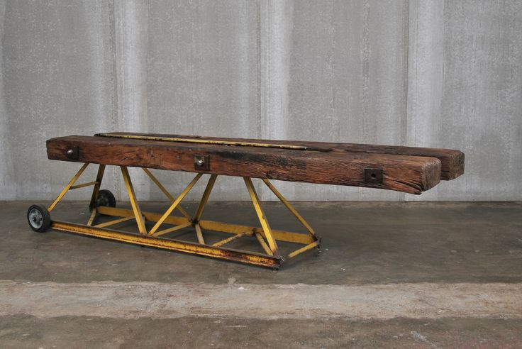 TAVOLO GRU / GRU TABLE Gru Table made with the union of the tip of a crane with two sleepers taken form the rail lines. Orvett Design