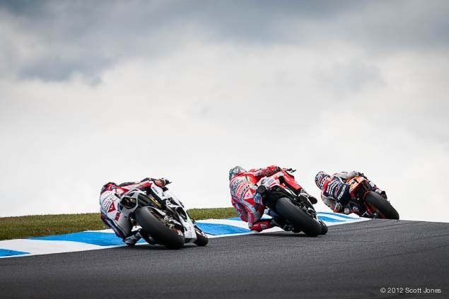 MotoGP, lining up, backing in and through the corner.