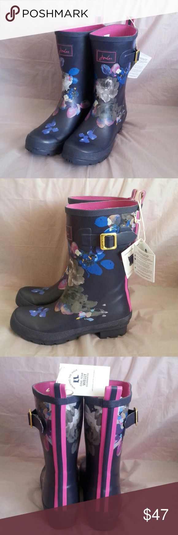 Molly Welly Rain Boots by: Joules Wellie Navy Floral  -Tyre-inspired outsole for effective water dispersal & grip. -Strap & buckle design feature. -Handmade w/ natural leather. Why b cute wet when u can walk around cute & dry. Joules Wellie Shoes Winter & Rain Boots
