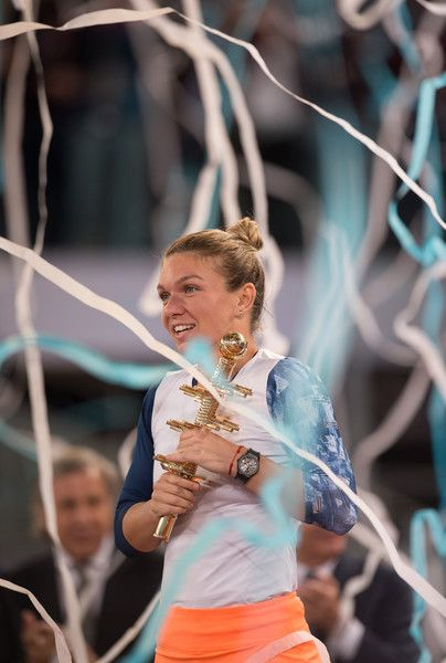 Simona Halep Photos Photos - Simona Halep of Romania celebrates with the trophy after beating Kristina Mladenovic of France in their final match during day eight of the Mutua Madrid Open tennis at La Caja Magica on May 13, 2017 in Madrid, Spain. - Mutua Madrid Open - Day Eight