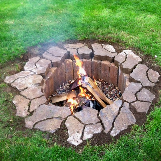 "Only cost $42 to make!!! Dig a 2ft deep hole four feet around. Purchase 25 4x4x12 pavers and 12 flagstone pavers. Put two bags of 3/4"" river rock in the bottom. It's so easy, we did it in just a little over an hour. (I'd get something different for the top pavers, I don't like this look with the mini flagstone pavers)"