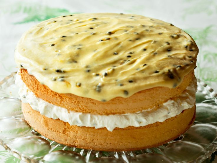 Feather sponge filled with clouds of whipped cream and topped with passionfruit icing.
