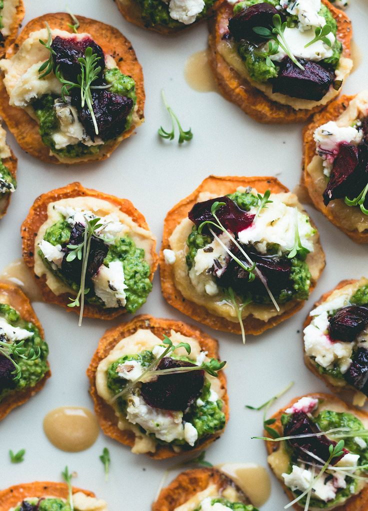 Sweet Potato Rounds with Hummus, Arugula Basil Pesto, Goat Cheese, Roasted Beets, Sprouts, and a drizzle of honey. Can be made vegan too! Gluten-free. | thehealthfulideas.com