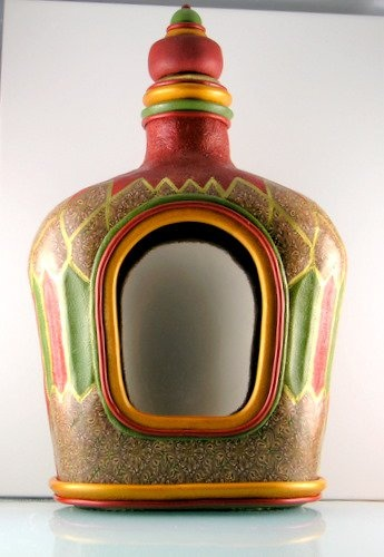 Recycled Crown Royal Bottle. Covered with polymer clay.