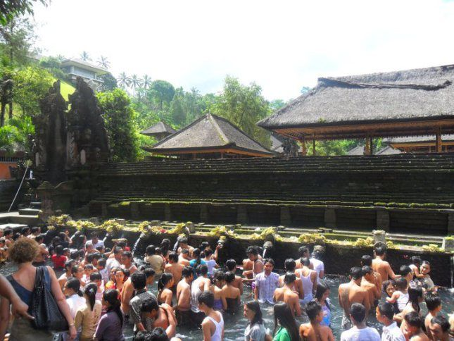 Balinese bathe at the holy spring Tirta Empul during Saraswati festival in Tampak Siring Village in Bali, Indonesia.