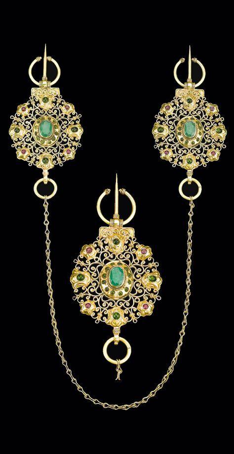 Morocco | Gem-set fibulae (Khallalat); gold, rubies, emeralds and coloured stones | 18th century | 7'500£ ~ sold (Apr '14)