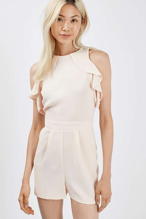 Bare shoulders are still a favourite. Dress yours up with a relaxed shape in this off-the-shoulder playsuit. Crafted in neutral nude, it features a pretty draped sleeve. Perfect worn with a simple strappy sandal for a party ready look. #Topshop