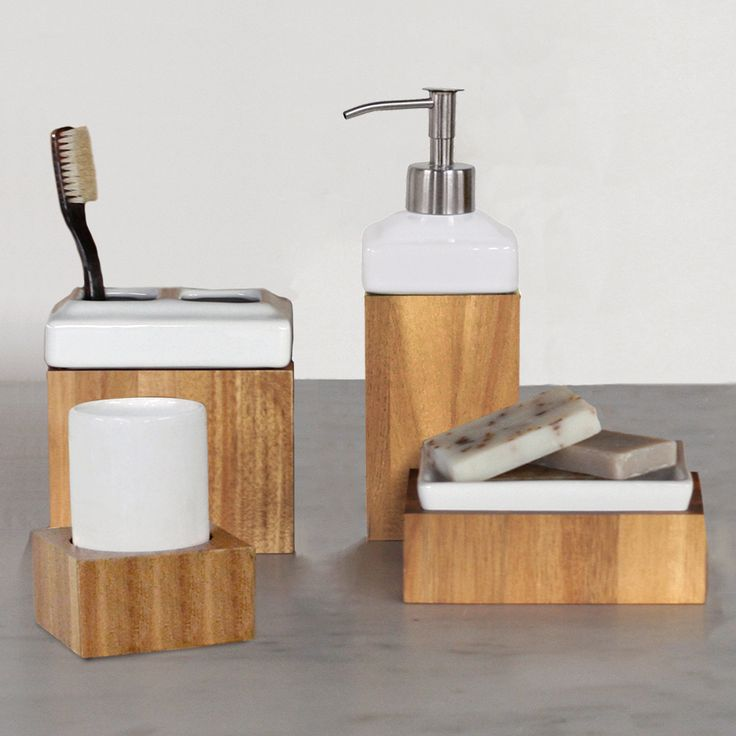 Complete any modern bathroom with the Ravine bath accessory collection. Made from honey colored acacia wood, this set includes one tumbler, one soap dish, one toothbrush holder and one lotion/soap dispenser.