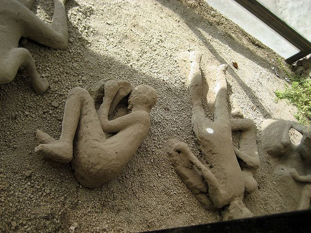 Pompeii's residents caught in the pyroclastic flow, their forms preserved in the lava.