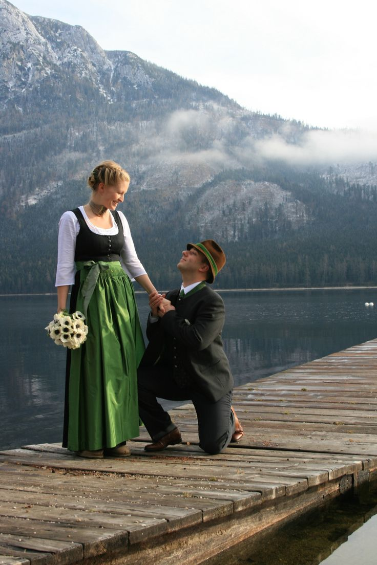 A couple wearing the traditional costume of Salzburg for their wedding #austria #salzburg #tracht #costume #dirndl #wedding #lake #mountains