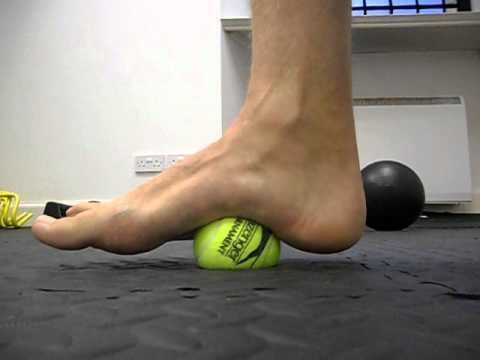Using a tennis ball, slowly roll and rock the ball along the arch as you apply light pressure. LOVE THIS! It really works. Loosens so many muscles in the legs and back. Definitely recommend!