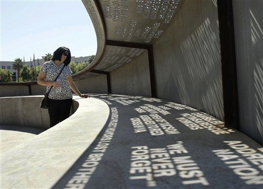 Sunlight shines through laser-cut phrases at the Moving Memories Memorial in Phoenix. The phrases are meant to reflect a range of thoughts from Arizonans affected by 9/11, and were picked after months of research.