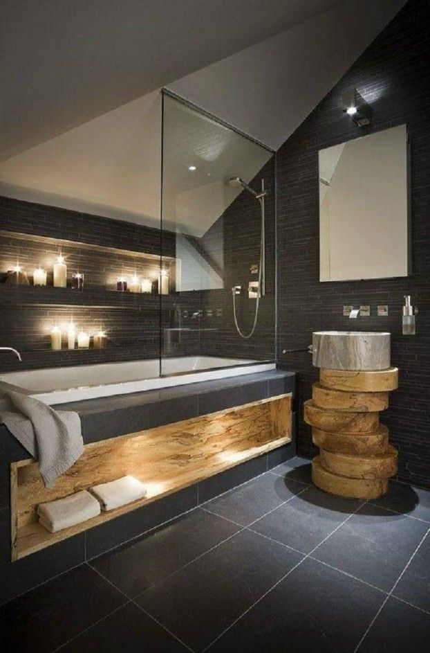 Gorgeous slate bathroom with live edge wood slab accents.