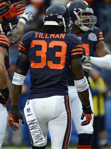 Chicago Bears cornerback Charles Tillman (33) pays tribute to the victims of the Sandy Hook Elementary School shooting.  Mike DiNovo, USA TODAY Sports