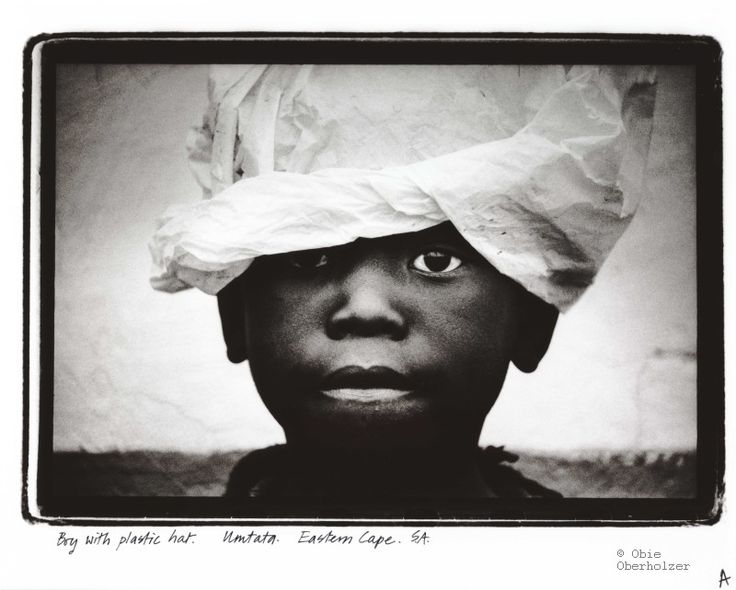 Africa | Boy with plastic hat. Umtata, Eastern Cape, South Africa | ©Obie Oberholzer