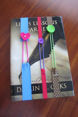 Bookmark made from ribbon, button, and hair rubberband. Simple hand stitching project. Going to have to make mom some!