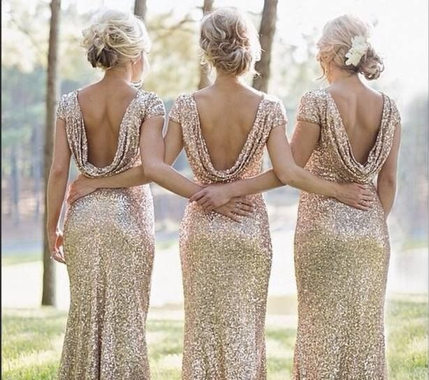 Maybe gold glitter dresses with an emerald satin sash and pink bouquet with matching sash or showing the stems??