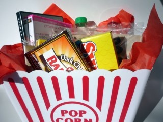 Homemade Christmas gift-Movie night bucket! I will make this for our annual Steal Your Freaking Gift game with family. I think this is great for a guy gift. Instead of a movie I'm putting Red Box money in there (since you never know if someone already has a movie),some candy, popcorn, and beef jerky. All of that can be bought at Dollar Tree. :)