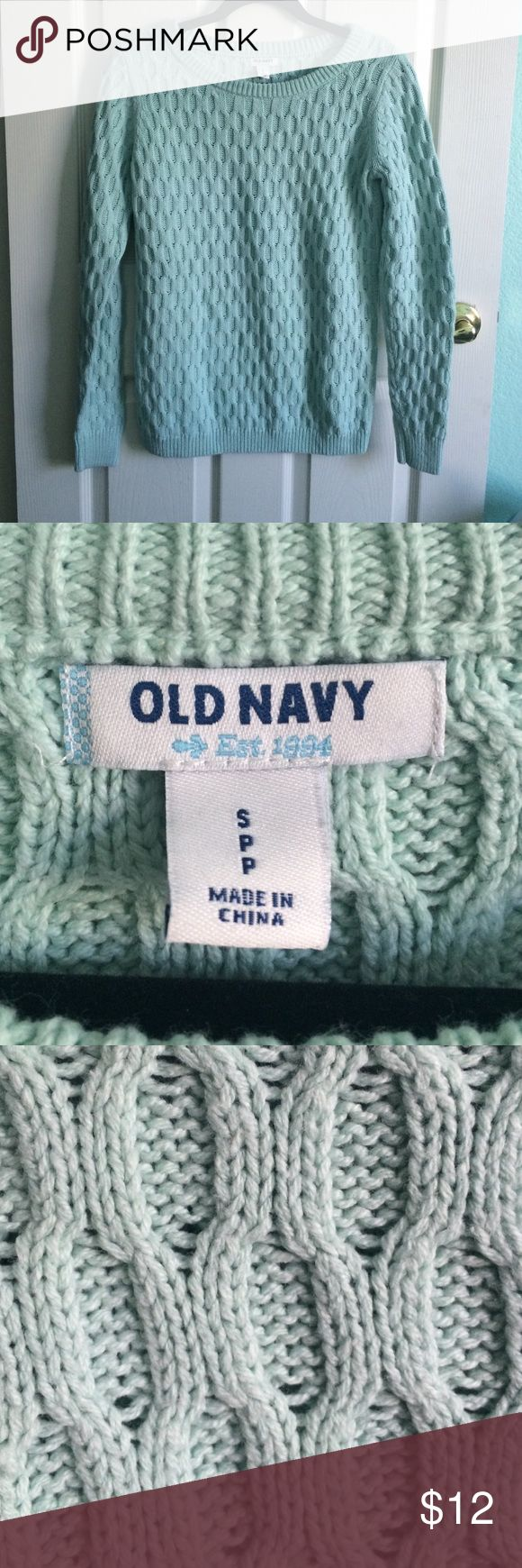 Old Navy Sweater This has been used very lightly and has no flaws! It is very warm and comfy for use in the winter, and goes with virtually everything, since it's mint green. Closet must! Old Navy Sweaters