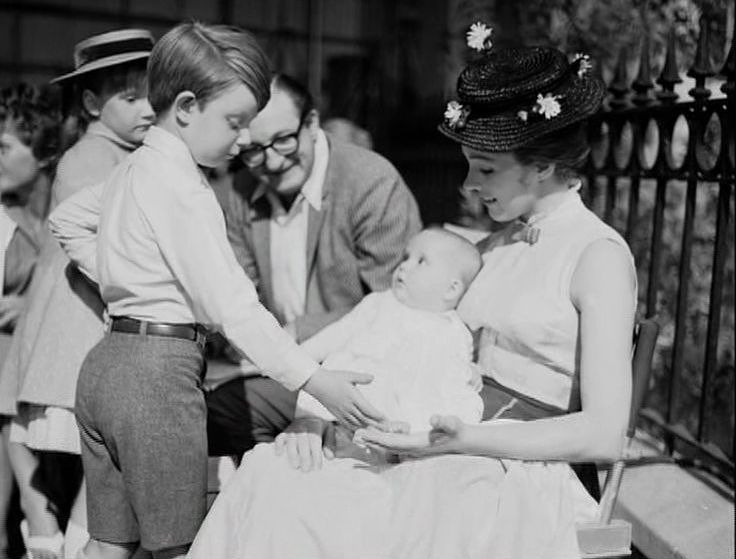 Matthew Garber and Julie Andrews max and relax with her daughter Emma between takes of Mary Poppins (1964). Join us as we discuss and gush on the Podcast about this amazing movie. . #betweentakes #bts #behindthescenes #lookatthebaby #famouskids #julieandrews #dickvandyke #glynisjohns #elsalanchester #davidtomlinson #robertstevenson #tonywalton #musical #academyawardwinner #disney #disneyproduction #marypoppins #petemenefee #nannylife #nanny