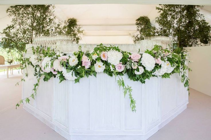 Our whitewashed bar decorated in foliage green