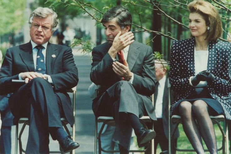 Senator Edward Kennedy, Massachussetts Governor Michael Dukakis and Jacqueline Kennedy Onassis.at the dedication of a park in Cambridge in honor of the late president on May 29, 1987, which would have been his 70th birthday.