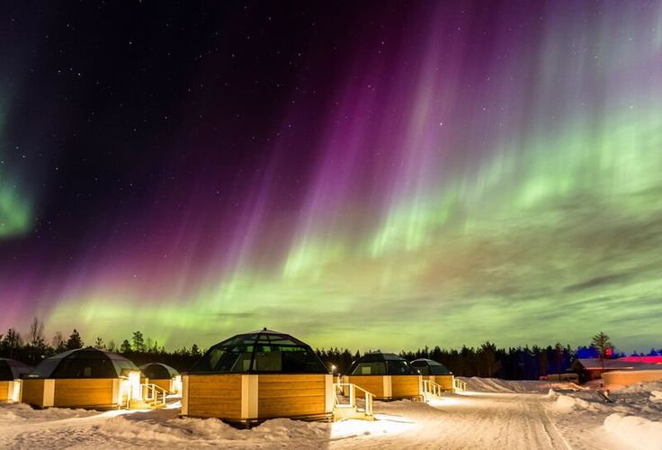 SnowHotel in Kirkenes, Norway. Glass igloos and colorful Northern Lights