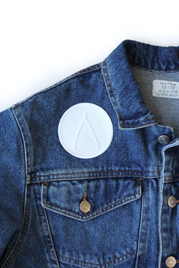 Wishbone minimalist iron on patch on denim jacket