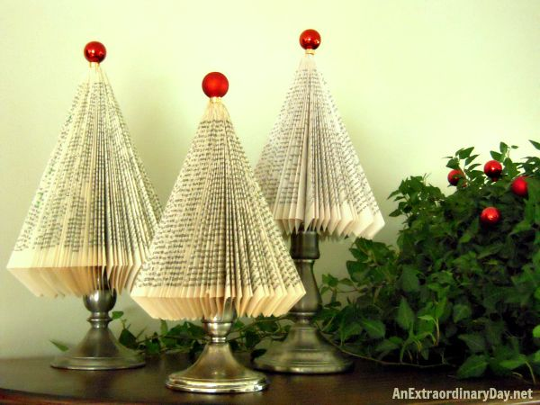 Book pages turned Christmas Trees. Great tutorial on how to turn a paperback book into these adorable trees.
