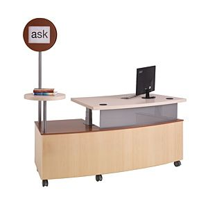 One version of a mobile reference/circ desk.  Probably my favorite because it has the sign pointing out what the desk is for.