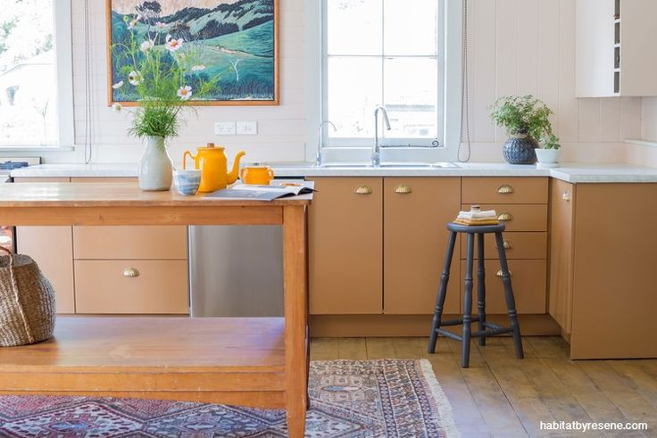 The long term plan is to remodel the 90s kitchen. In the meantime Jo and Jeremy have painted over the beige walls with soft blush Resene Just Right, and have updated the cabinets in Resene Brown Sugar. Photo by Holly Marie Russell.