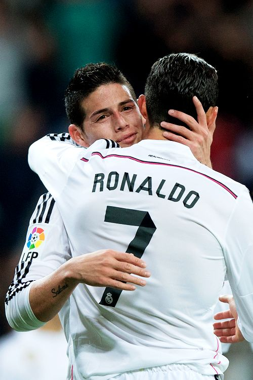 Cristiano Ronaldo celebrates scoring their third goal with teammate James Rodriguez during the La Liga match between Real Madrid CF and Malaga CF at Estadio Santiago Bernabeu on April 18, 2015 in Madrid, Spain.