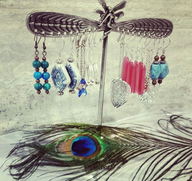 Having small pewter jewelry displays like this to hang our longer dangling earrings is a must to keep our space clean and clutter free.
