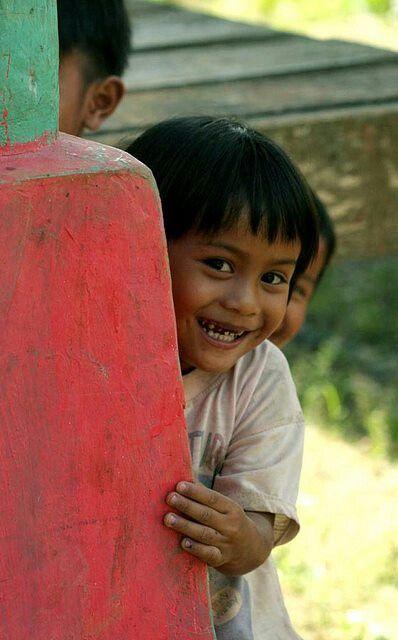 Toraja kid hiding. Rantepao, Indonesia.