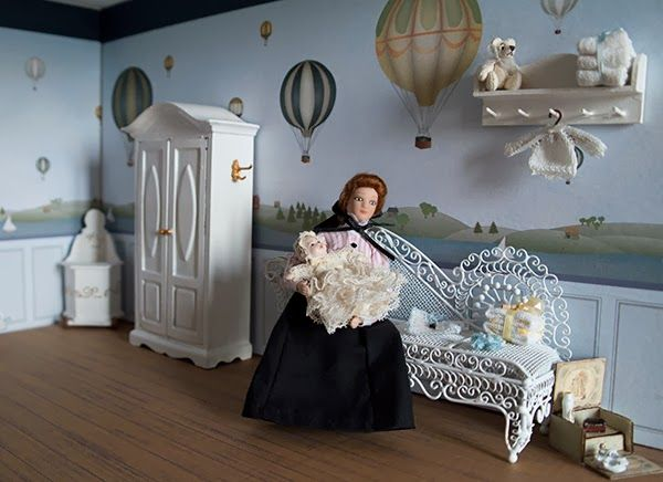 The nursery of the dollhouse that I build in a display case