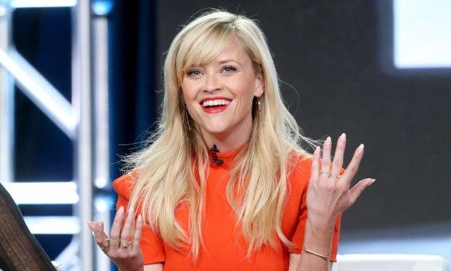 VIL BIDRA TIL ENDRING: Reese Witherspoon mener Hollywood må begynne å fremstille kvinner slik de er i virkeligheten, og ikke bare som koner eller kjærester. FOTO: Frederick M. Brown / AFP / NTB Scanpix