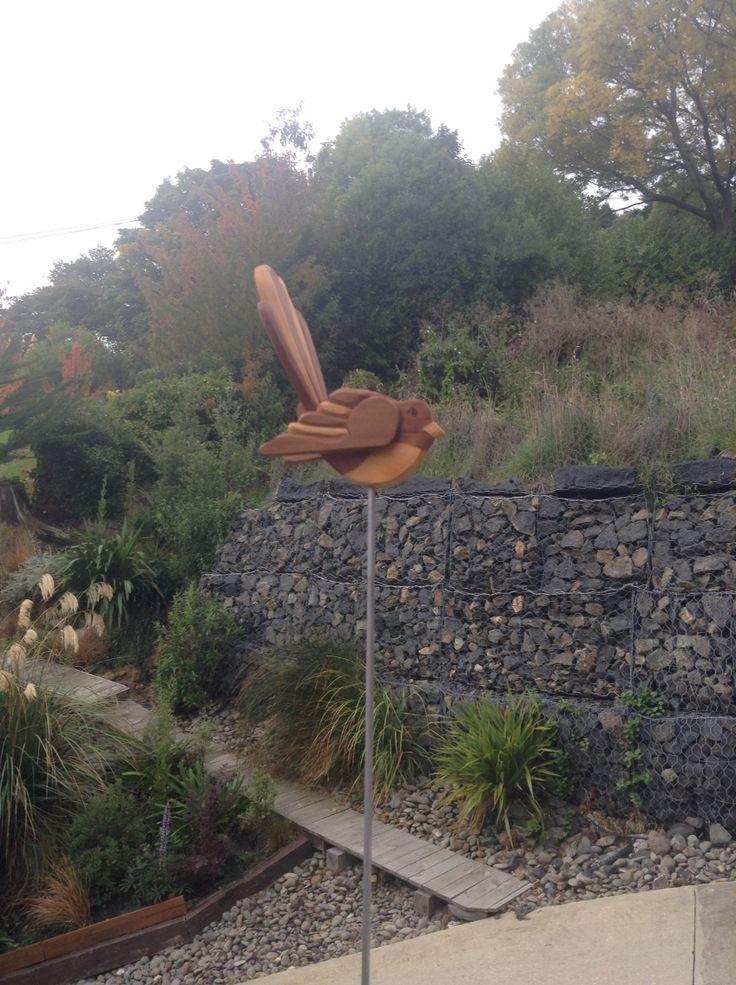 Here is a little wooden fan tail in our garden